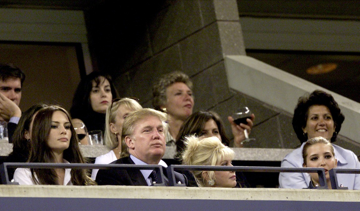 Donald Trump watches Venus and Serena Williams compete during the women's final match of the US Open with his girlfriend Melania Knauss (L), his ex-wife Ivana Trump and their daughter Ivanka (R) September 8, 2001 at the USTA National Tennis Center in Flushing, NY.
