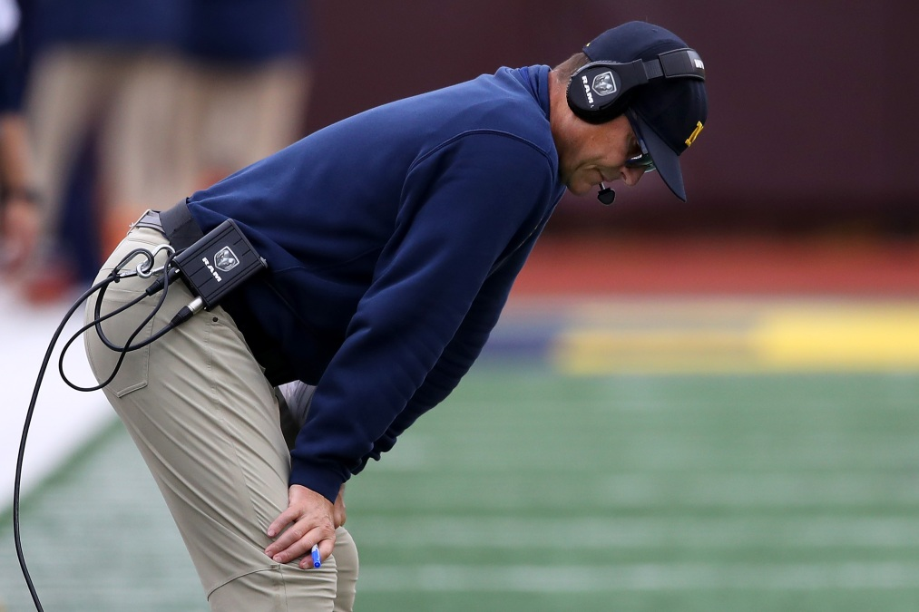 Head coach Jim Harbaugh of the Michigan Wolverines looks on in the first half while playing the Rutgers Scarlet Knights at Michigan Stadium