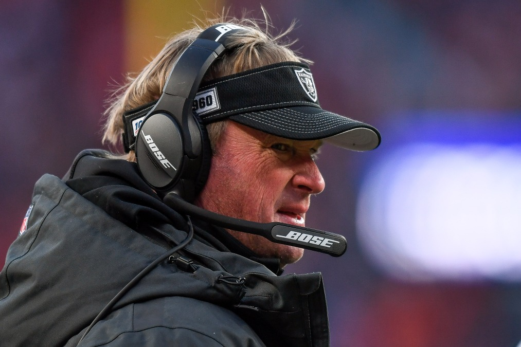 Head coach Jon Gruden of the Oakland Raiders looks on from the sideline during a game