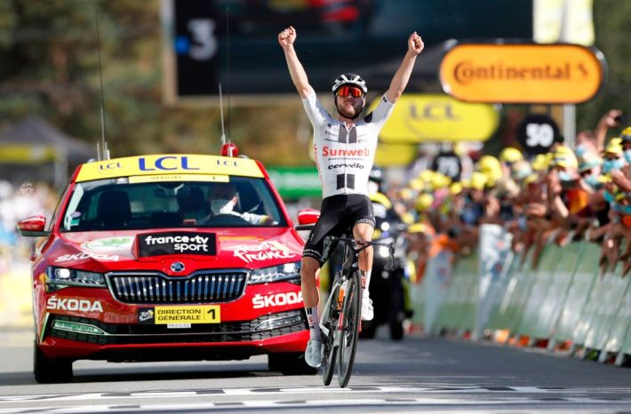 Marc Hirschi in victory at the Tour de France.