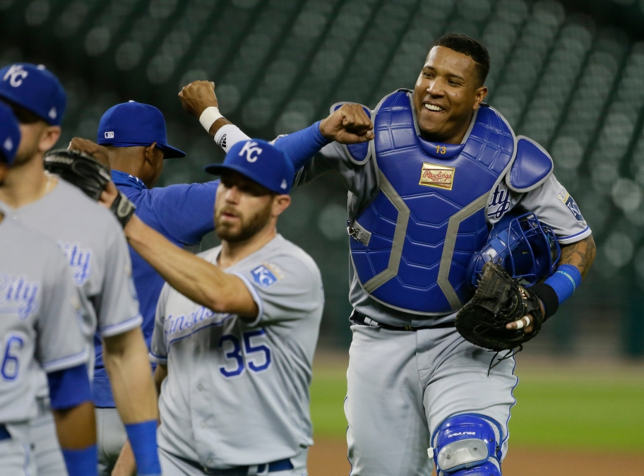 Salvador Perez congratulates his teammates, all of whom are somehow much smaller than him.