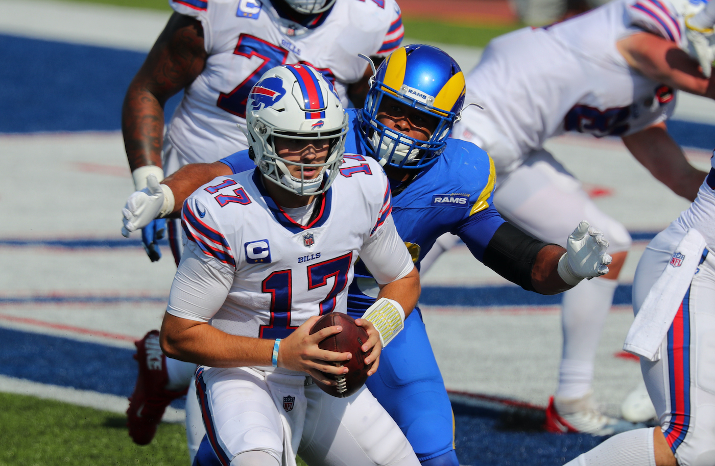 ORCHARD PARK, NY - SEPTEMBER 27: Josh Allen #17 of the Buffalo Bills looks to throw a pass and gets tackled by Aaron Donald #99 of the Los Angeles Rams during the second half at Bills Stadium on September 27, 2020 in Orchard Park, New York. Bills beat the Rams 35 to 32. (Photo by Timothy T Ludwig/Getty Images)