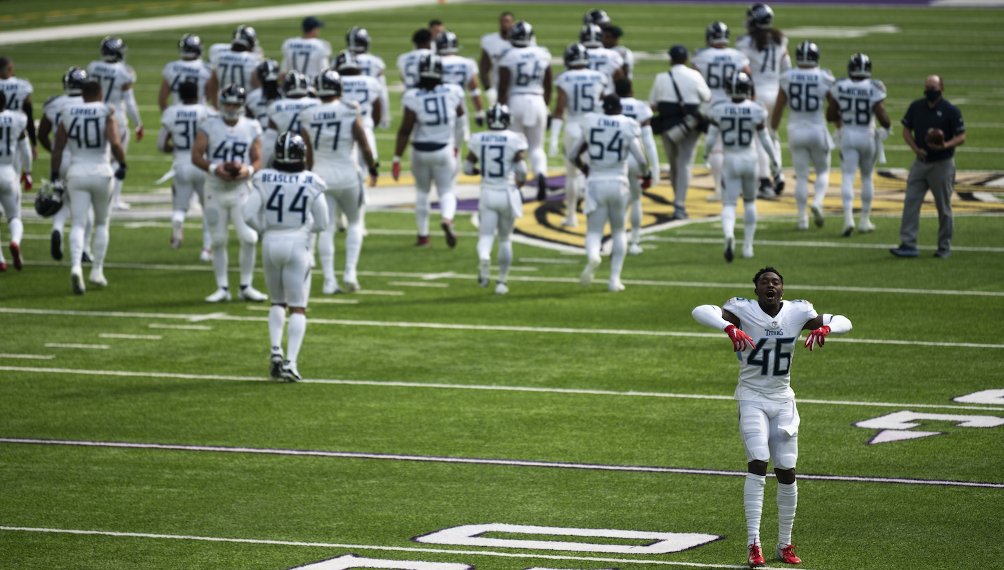 Joshua Kalu #46 of the Tennessee Titans and his teammates take the field before the game against the Minnesota Vikings at U.S. Bank Stadium on September 27, 2020 in Minneapolis, Minnesota.