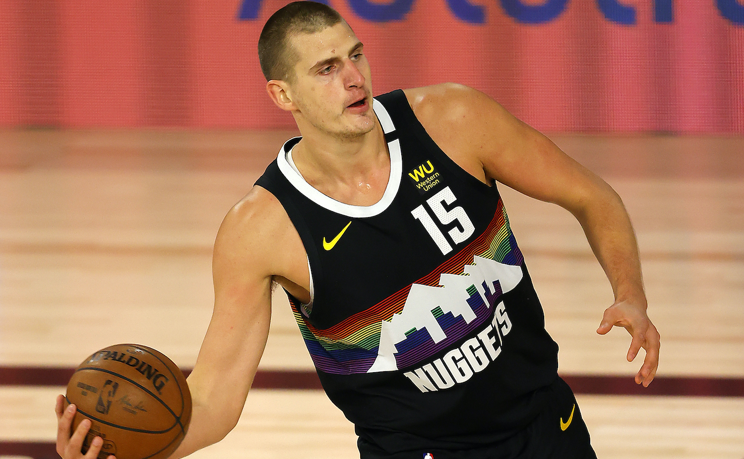 LAKE BUENA VISTA, FLORIDA - AUGUST 25: Nikola Jokic #15 of the Denver Nuggets handles the ball against the Utah Jazz during the first quarter in Game Five of the Western Conference First Round during the 2020 NBA Playoffs at The Field House at ESPN Wide World Of Sports Complex on August 25, 2020 in Lake Buena Vista, Florida. NOTE TO USER: User expressly acknowledges and agrees that, by downloading and or using this photograph, User is consenting to the terms and conditions of the Getty Images License Agreement. (Photo by Mike Ehrmann/Getty Images)