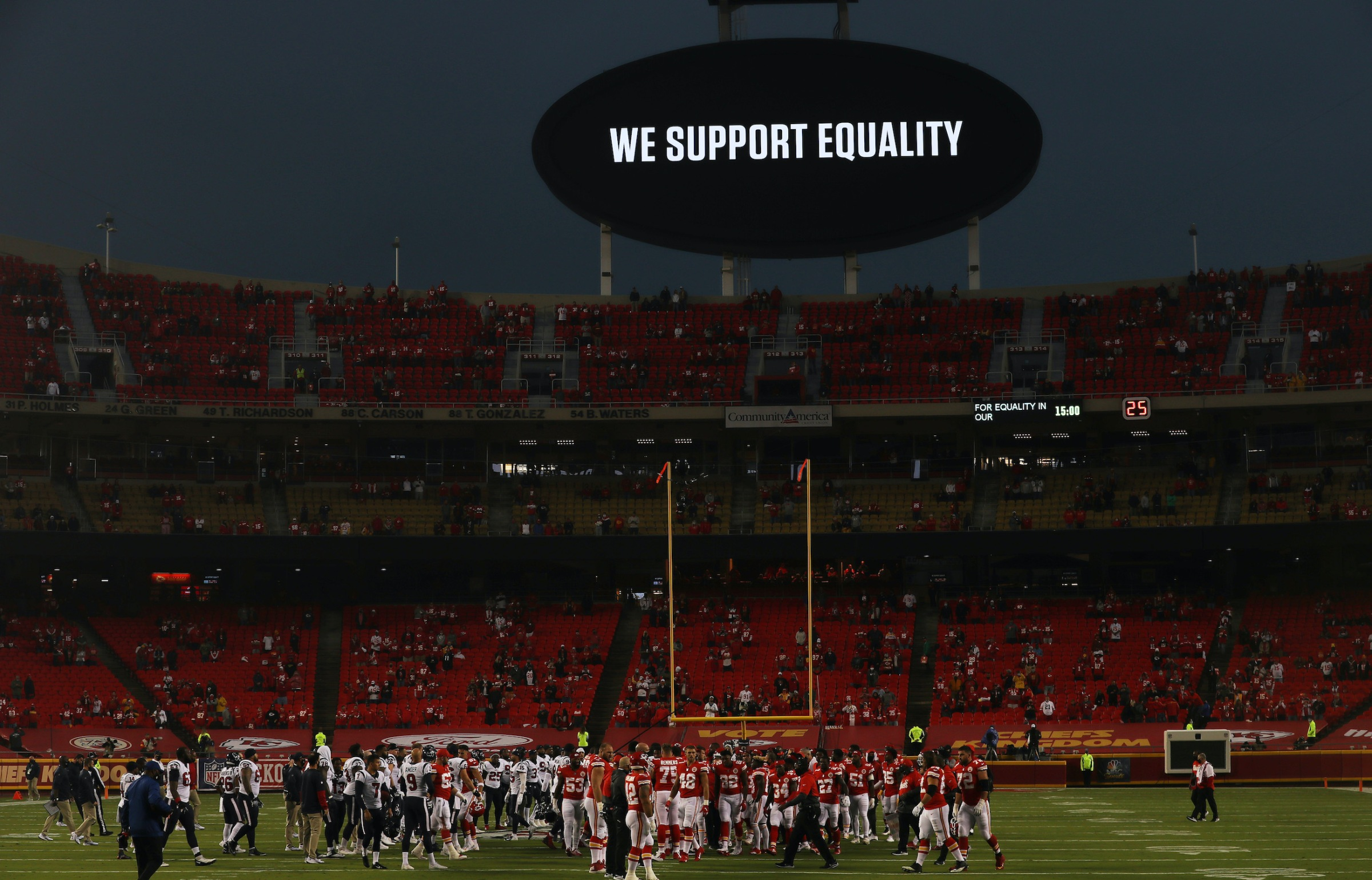 KANSAS CITY, MISSOURI - SEPTEMBER 10: Players from the Kansas City Chiefs and Houston Texans unite in a moment of silence before the start of a game at Arrowhead Stadium on September 10, 2020 in Kansas City, Missouri. (Photo by Jamie Squire/Getty Images)