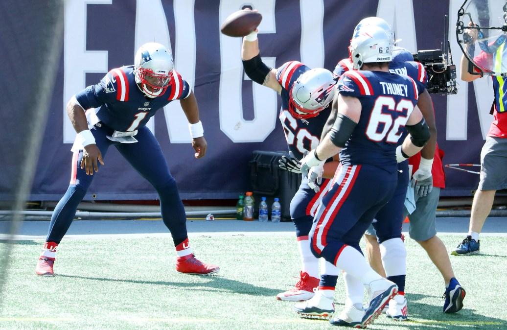 Cam Newton celebrates touchdown with Patriots teammates