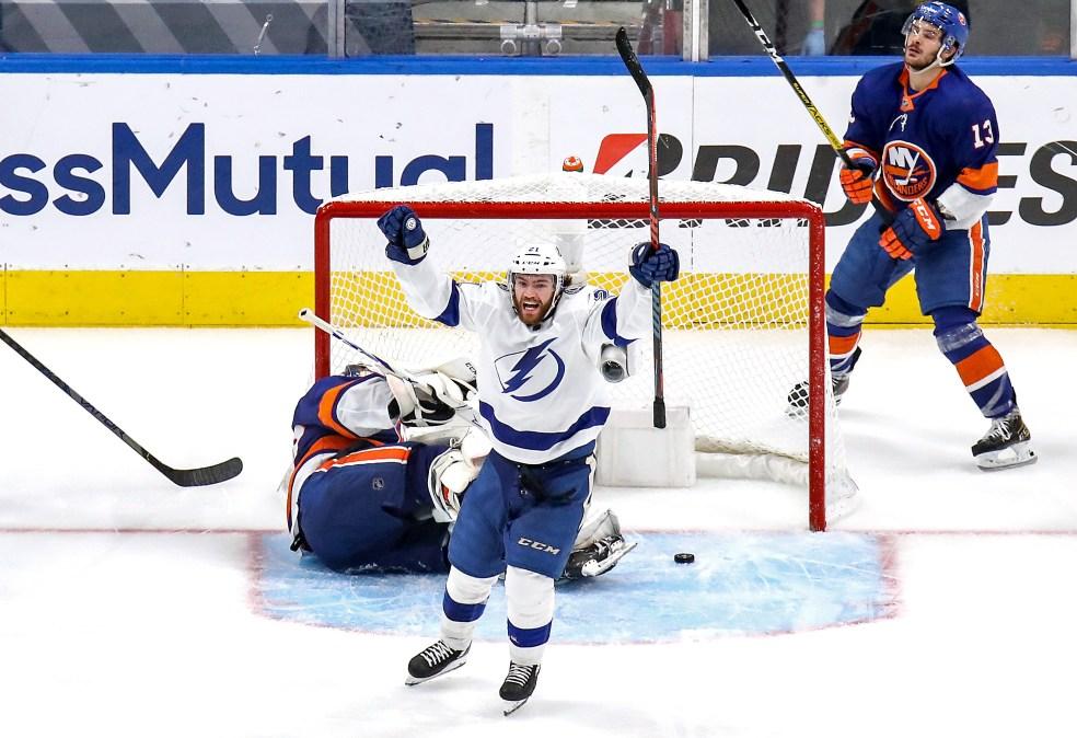 Brayden Point of the Tampa Bay Lightning celebrates after scoring a goal past Semyon Varlamov of the New York Islanders