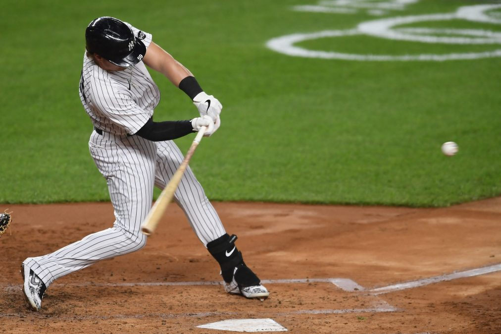 Luke Voit #59 of the New York Yankees hits a three-run home run during the second inning against the Toronto Blue Jays at Yankee Stadium