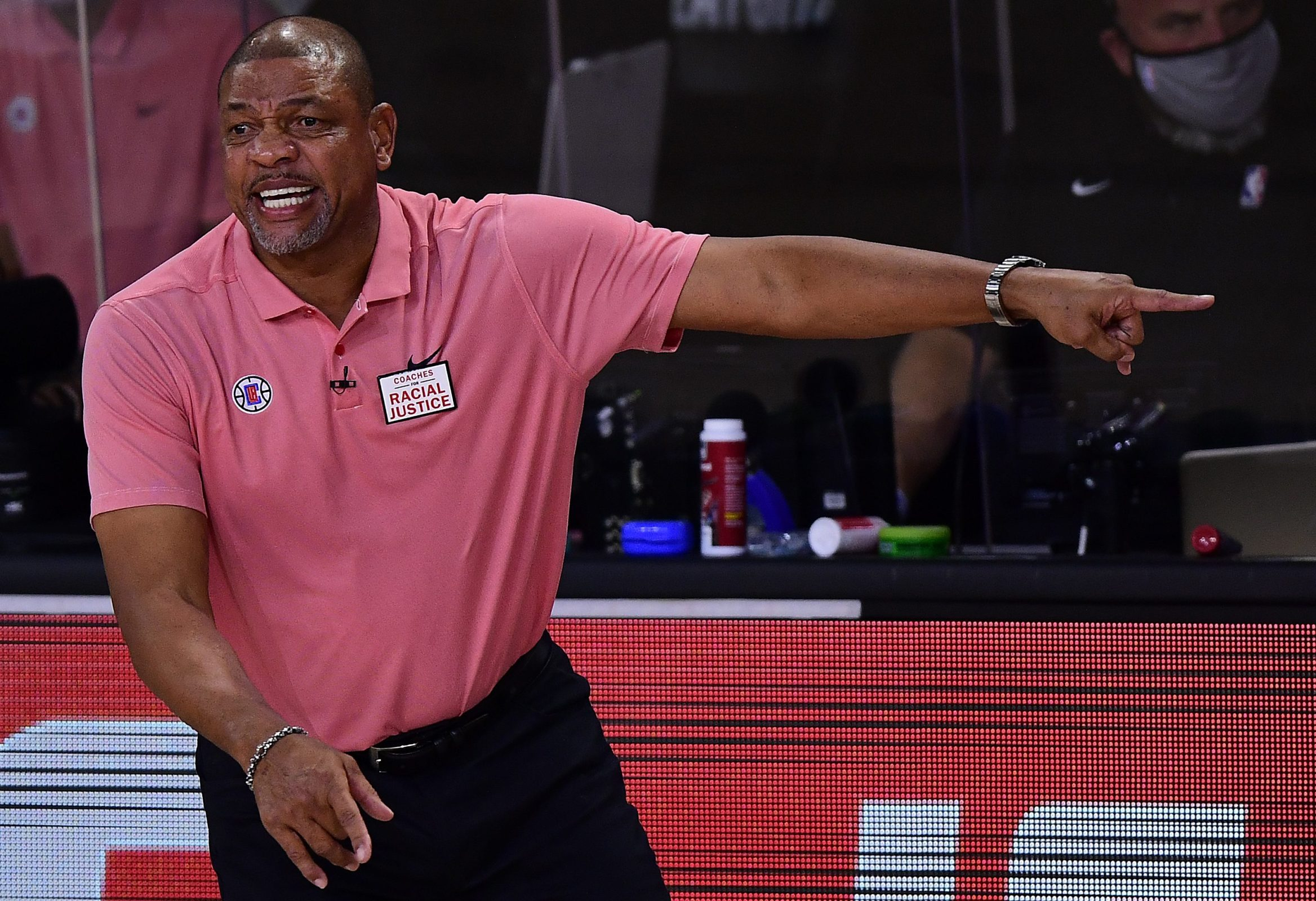 Doc Rivers looks amused on the sidelines of a Clippers playoff game.