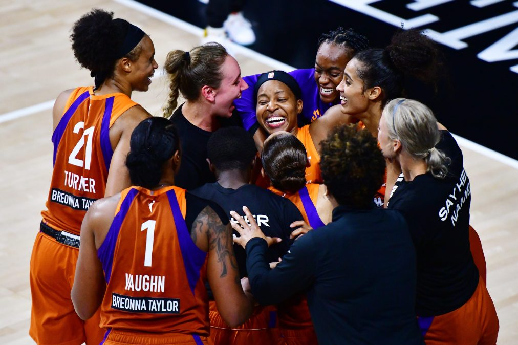 Shey Peddy #5 of the Phoenix Mercury is surrounded by teammates after hitting a 3-point buzzer beater to defeat the Washington Mystics at Feld Entertainment Center on September 15, 2020