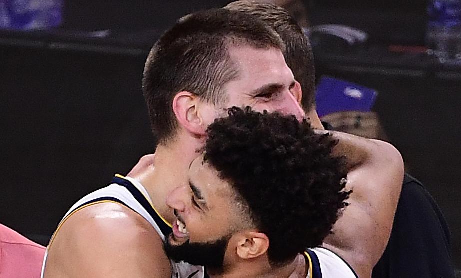 Jokic hugs Murray