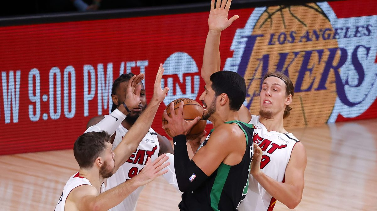 Enes Kanter is defended by three Miami Heat players