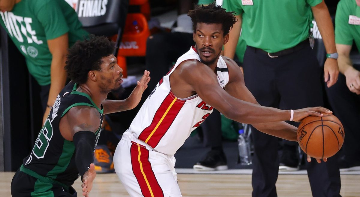 Jimmy Butler #22 of the Miami Heat handles the ball as Marcus Smart #36 of the Boston Celtics defends during the third quarter in Game Two of the Eastern Conference Finals during the 2020 NBA Playoffs at AdventHealth Arena at the ESPN Wide World Of Sports Complex on September 17, 2020 in Lake Buena Vista, Florida.