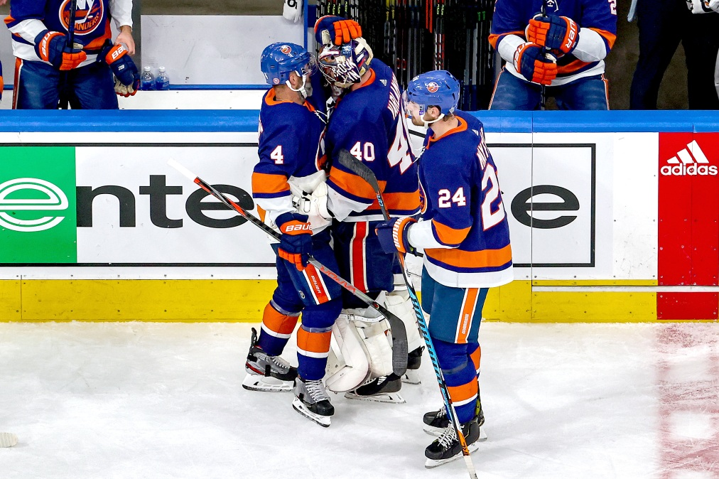 Semyon Varlamov #40 of the New York Islanders is consoled by Andy Greene #4 after the teams 2-1 defeat against the Tampa Bay Lightning during overtime as they lose Game Six of the Eastern Conference Final