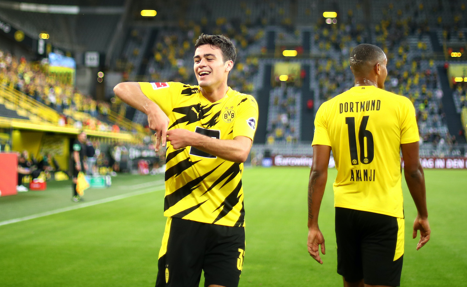 DORTMUND, GERMANY - SEPTEMBER 19: Giovanni Reyna of Borussia Dortmund celebrates after scoring his team's first goal during the Bundesliga match between Borussia Dortmund and Borussia Moenchengladbach at Signal Iduna Park on September 19, 2020 in Dortmund, Germany. Fans are set to return to Bundesliga stadiums in Germany despite to the ongoing Coronavirus Pandemic. Up to 20% of stadium's capacity are allowed to be filled. Final decisions are left to local health authorities and are subject to club's hygiene concepts and the infection numbers in the corresponding region. (Photo by Dean Mouhtaropoulos/Getty Images)