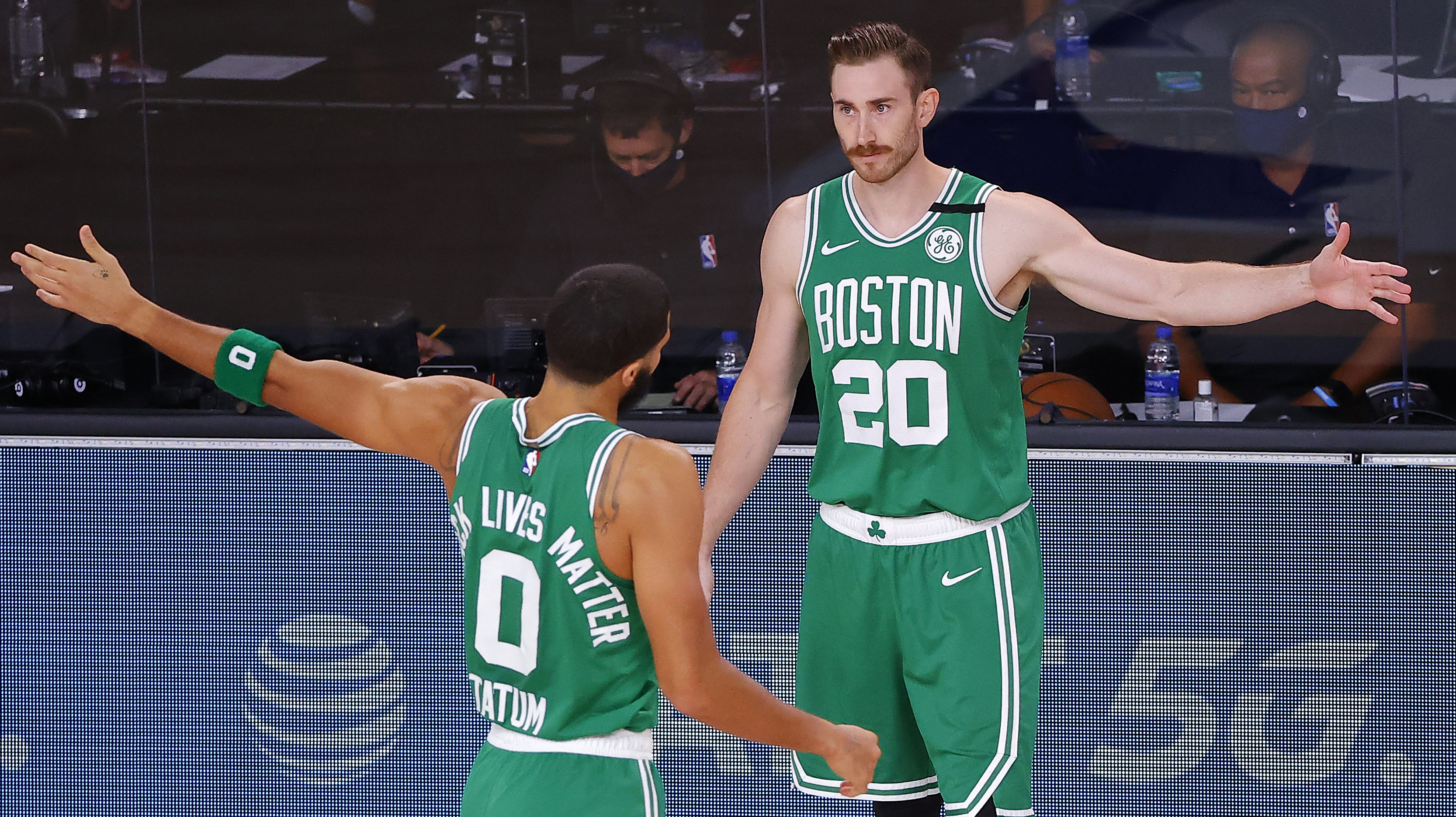 Gordon Hayward and Jayson Tatum greet each other on the sideline of a Celtics playoff game.