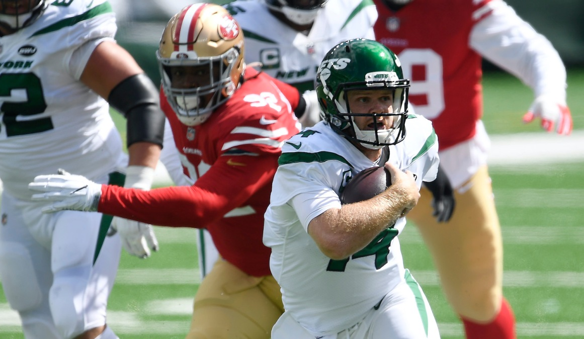Sam Darnold of the Jets tries to avoid a sack.