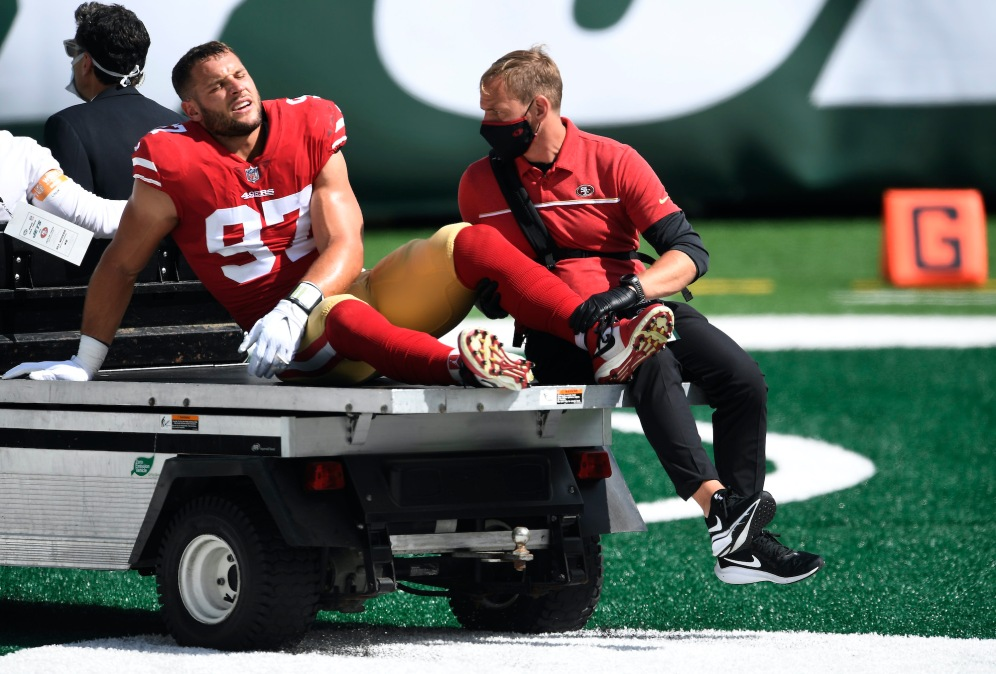 EAST RUTHERFORD, NEW JERSEY - SEPTEMBER 20: Nick Bosa #97 of the San Francisco 49ers is carted off the field after sustaining an injury during the first half against the New York Jets at MetLife Stadium on September 20, 2020 in East Rutherford, New Jersey. (Photo by Sarah Stier/Getty Images)