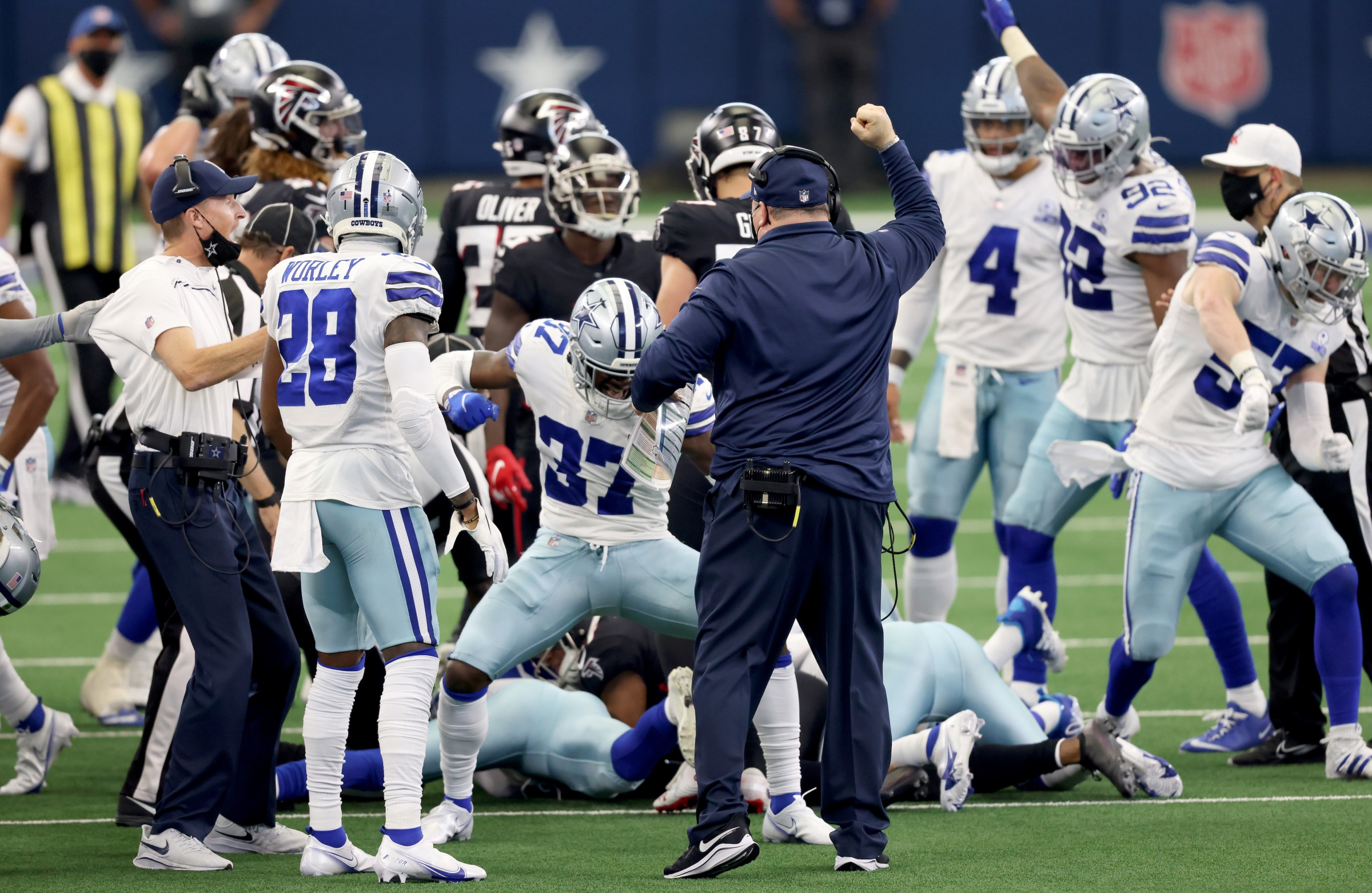 Dallas Cowboys players react to onside kick recovery