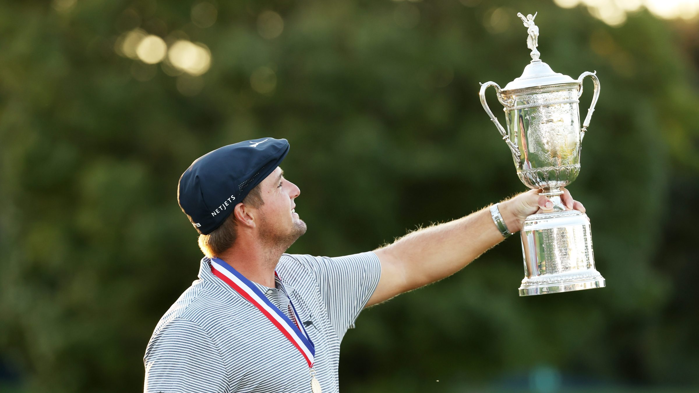 Bryson DeChambeau admires the U.S. Open Championship Trophy after winning the 2020 U.S. Open at Winged Foot.