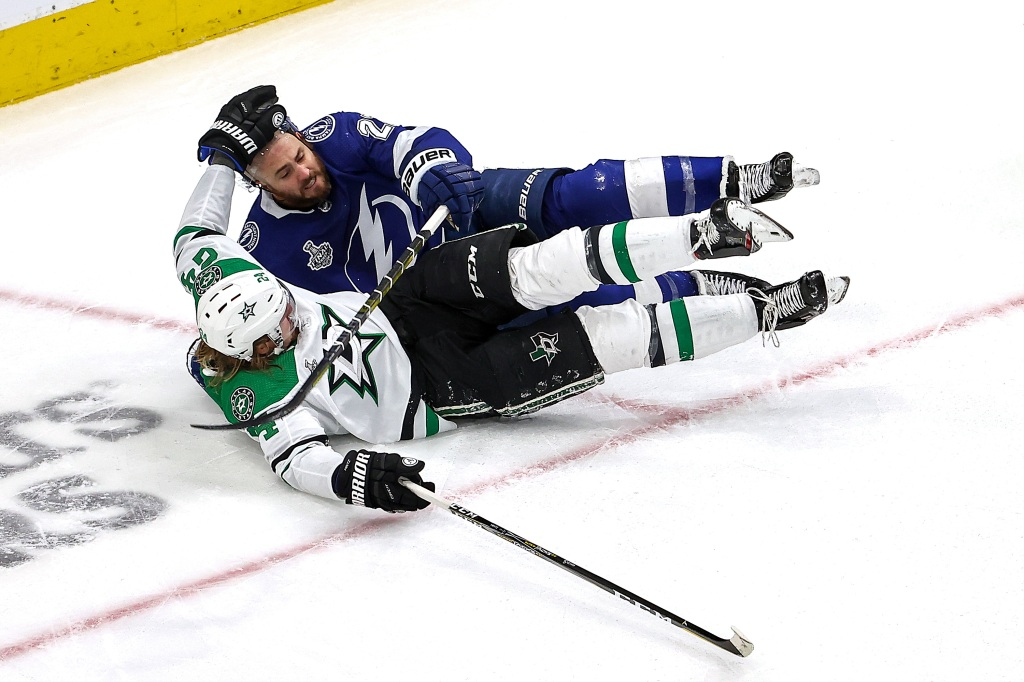 Roope Hintz #24 of the Dallas Stars gets tried up with Kevin Shattenkirk #22 of the Tampa Bay Lightning