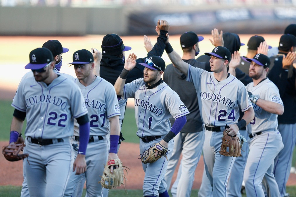 Colorado Rockies players celebrate after their win against the San Francisco Giants