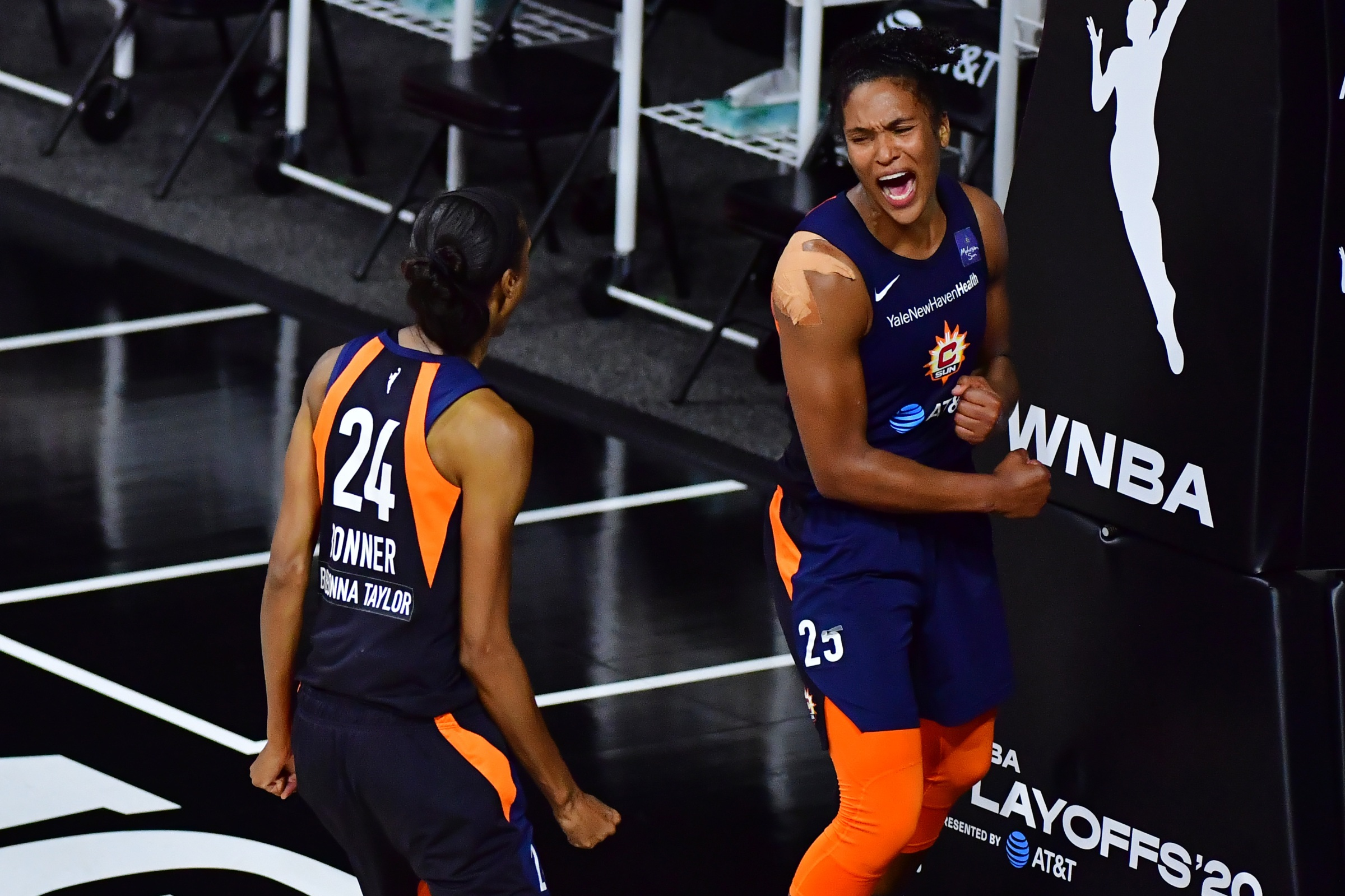 Alyssa Thomas #25 of the Connecticut Sun celebrates with DeWanna Bonner #24 after converting a steal in the fourth quarter against the Las Vegas Aces during Game Three of their Third Round playoff at Feld Entertainment Center on September 24, 2020 in Palmetto, Florida.