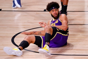 JaVale McGee of the Los Angeles Lakers makes a funny face while seated on the floor