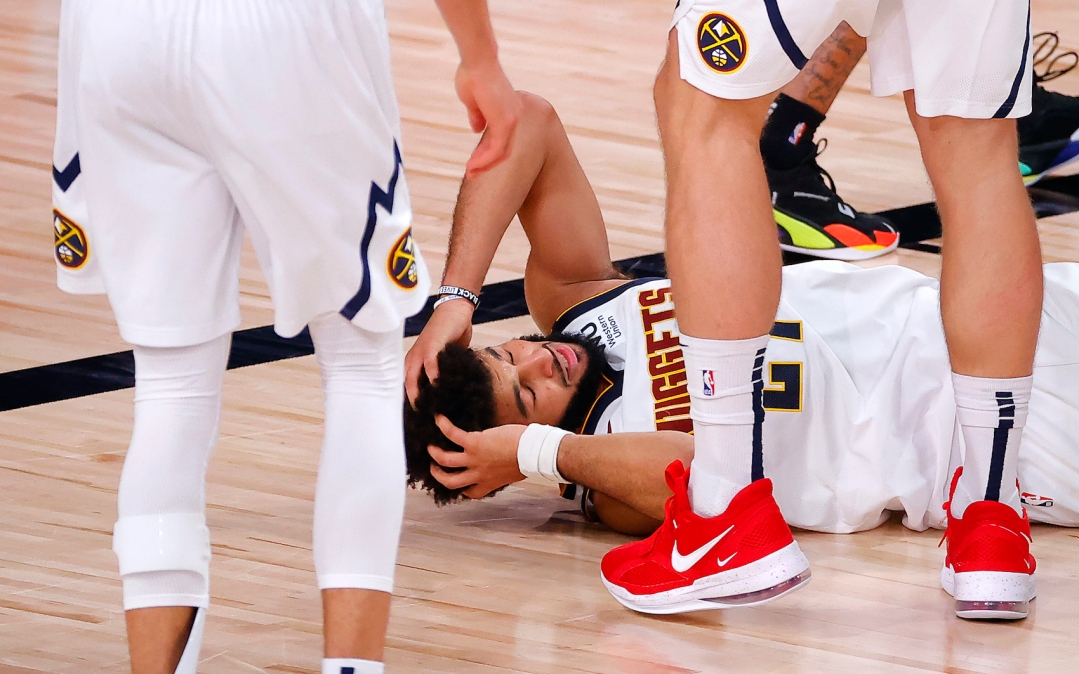 LAKE BUENA VISTA, FLORIDA - SEPTEMBER 26: Jamal Murray #27 of the Denver Nuggets reacts during the fourth quarter against the Los Angeles Lakers in Game Five of the Western Conference Finals during the 2020 NBA Playoffs at AdventHealth Arena at the ESPN Wide World Of Sports Complex on September 26, 2020 in Lake Buena Vista, Florida. NOTE TO USER: User expressly acknowledges and agrees that, by downloading and or using this photograph, User is consenting to the terms and conditions of the Getty Images License Agreement. (Photo by Kevin C. Cox/Getty Images)