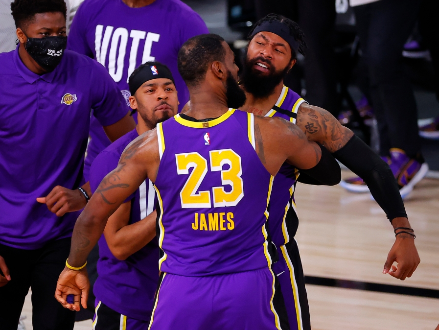 LeBron James and Markieff Morris of the Lakers chest-bump during a victorious Game 5 of the Western Conference Finals.