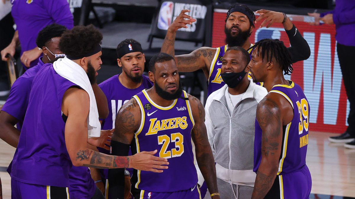 LeBron James mean-mugs while his Lakers teammates celebrate