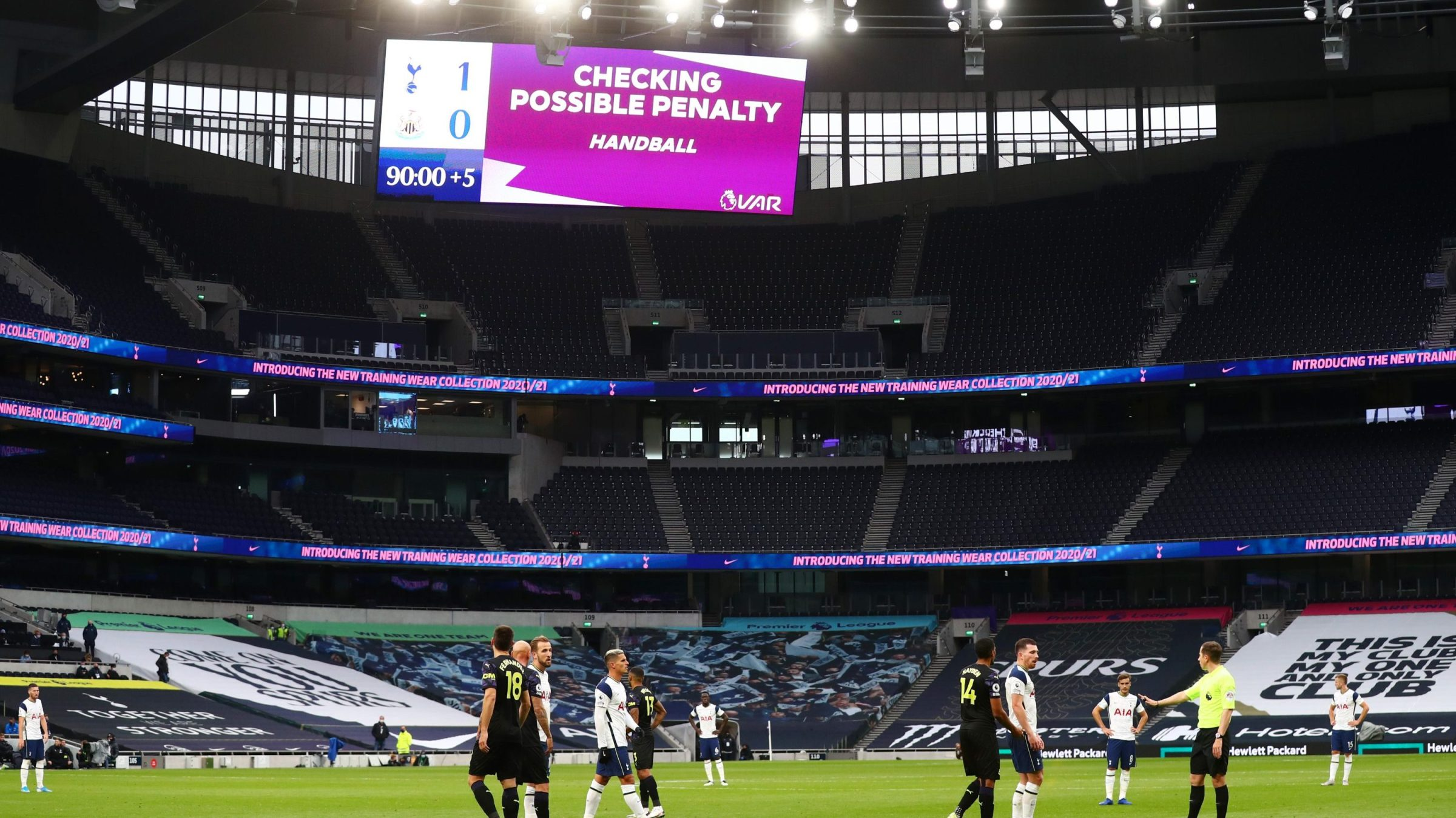 A screen inside the stadium displays the decision to check VAR for a possible penalty during the Premier League match between Tottenham Hotspur and Newcastle United at Tottenham Hotspur Stadium on September 27, 2020