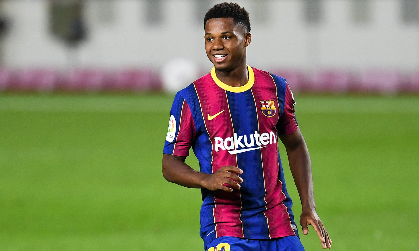 Ansu Fati of FC Barcelona smiles during the La Liga Santander match between FC Barcelona and Villarreal CF at Camp Nou on September 27, 2020 in Barcelona, Spain. Football Stadiums around Europe remain empty due to the Coronavirus Pandemic as Government social distancing laws prohibit fans inside venues resulting in fixtures being played behind closed doors.