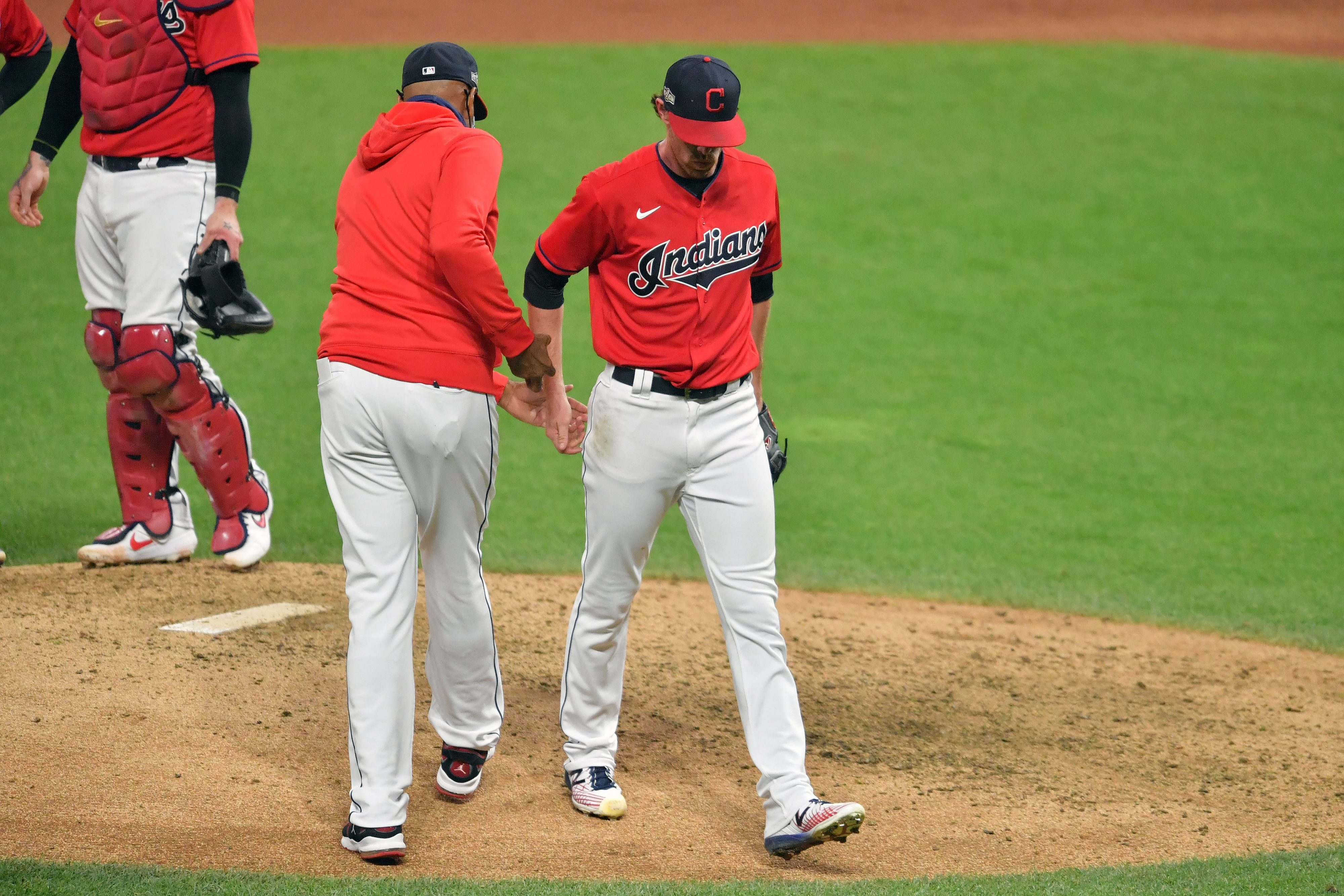 Interim manager Sandy Alomar Jr. #15 removes starting pitcher Shane Bieber #57 of the Cleveland Indians from the game during the fifth inning after giving up a two run homer