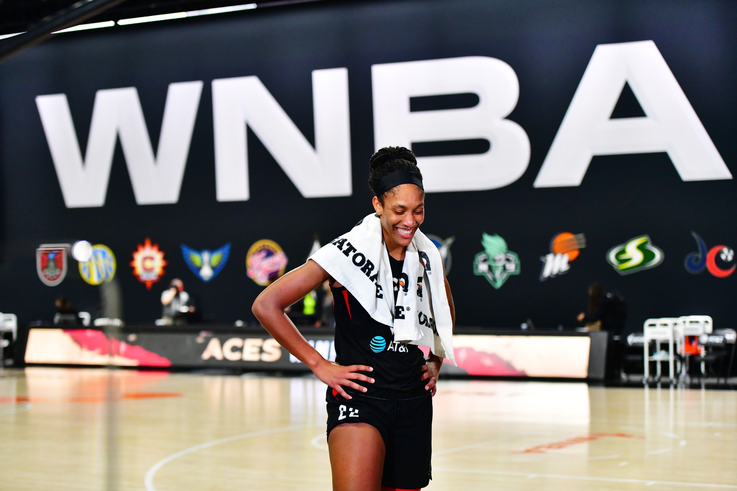 A'ja Wilson #22 of the Las Vegas Aces smiles while getting interviewed after defeating the Connecticut Sun 66-63 to advance to the WNBA finals following Game Five of their Third Round playoff at Feld Entertainment Center on September 29, 2020 in Palmetto, Florida.