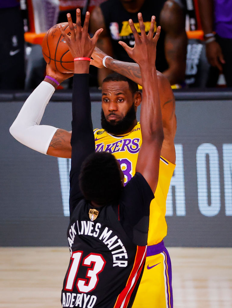 Bam Adebayo of the Miami Heat tries to annoy LeBron James of the Lakers, and looks like a tiny baby.
