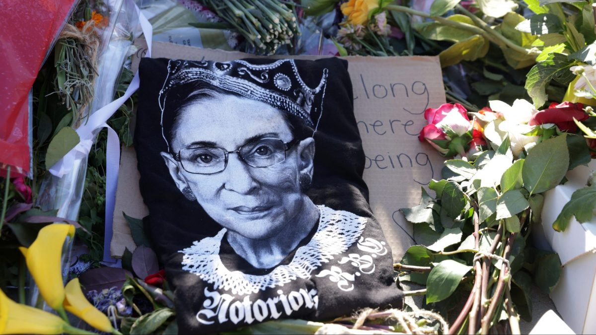 Signs and flowers are left at a makeshift memorial in front of the U.S. Supreme Court for the late Justice Ruth Bader Ginsburg September 21, 2020 in Washington, DC.