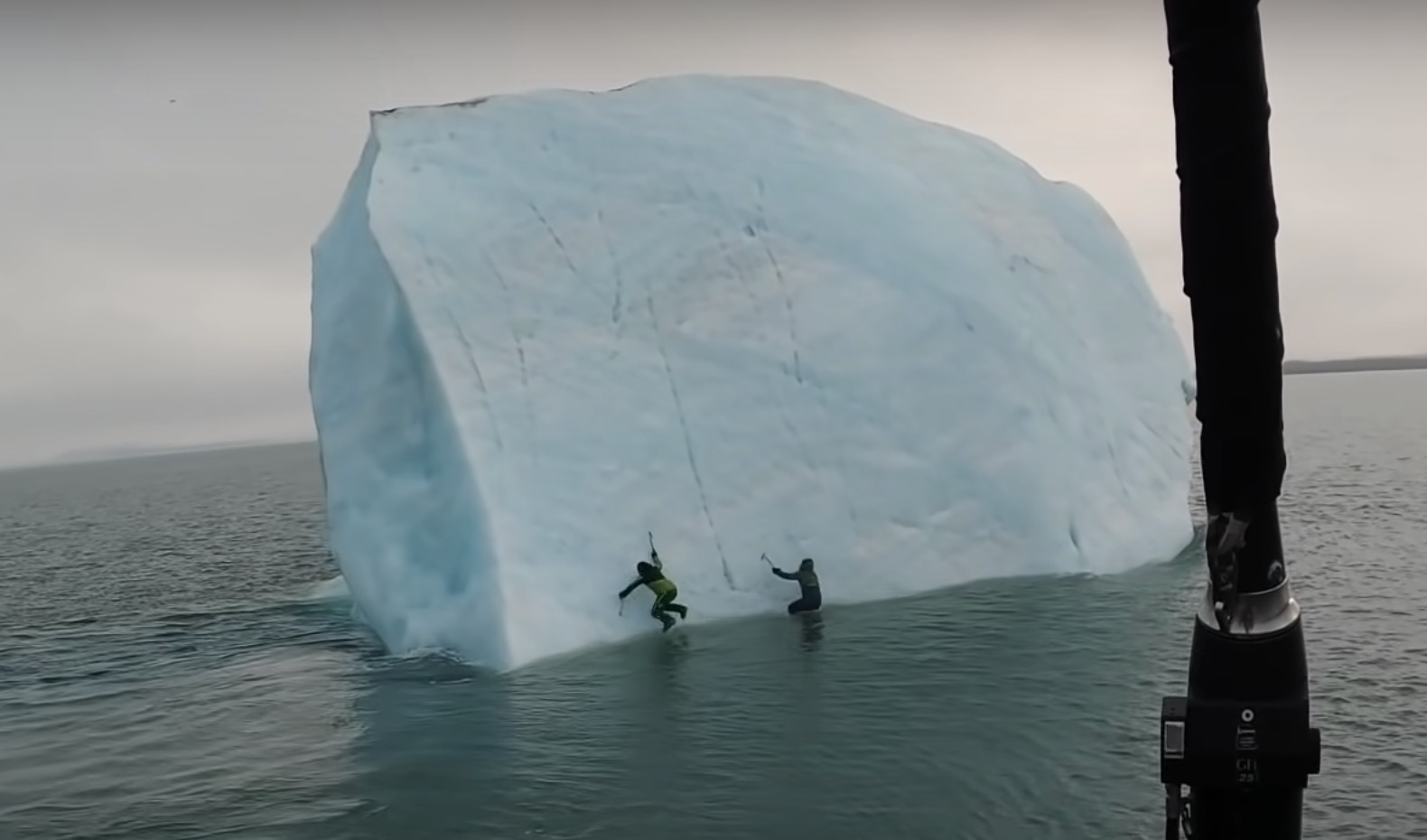 The two climbers scramble into the water.