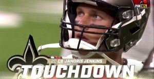 """It's a TV screenshot. Tom Brady looking up at the big screen—it's a close-up on his face. And there's a big graphic that says """"20 CB Janoris Jenkins TOUCHDOWN Saints"""" in front of him."""