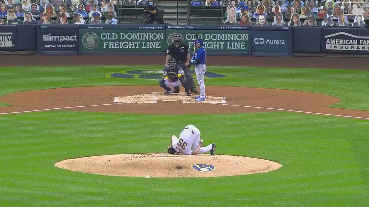 Brent Suter, falling over backwards on the mound