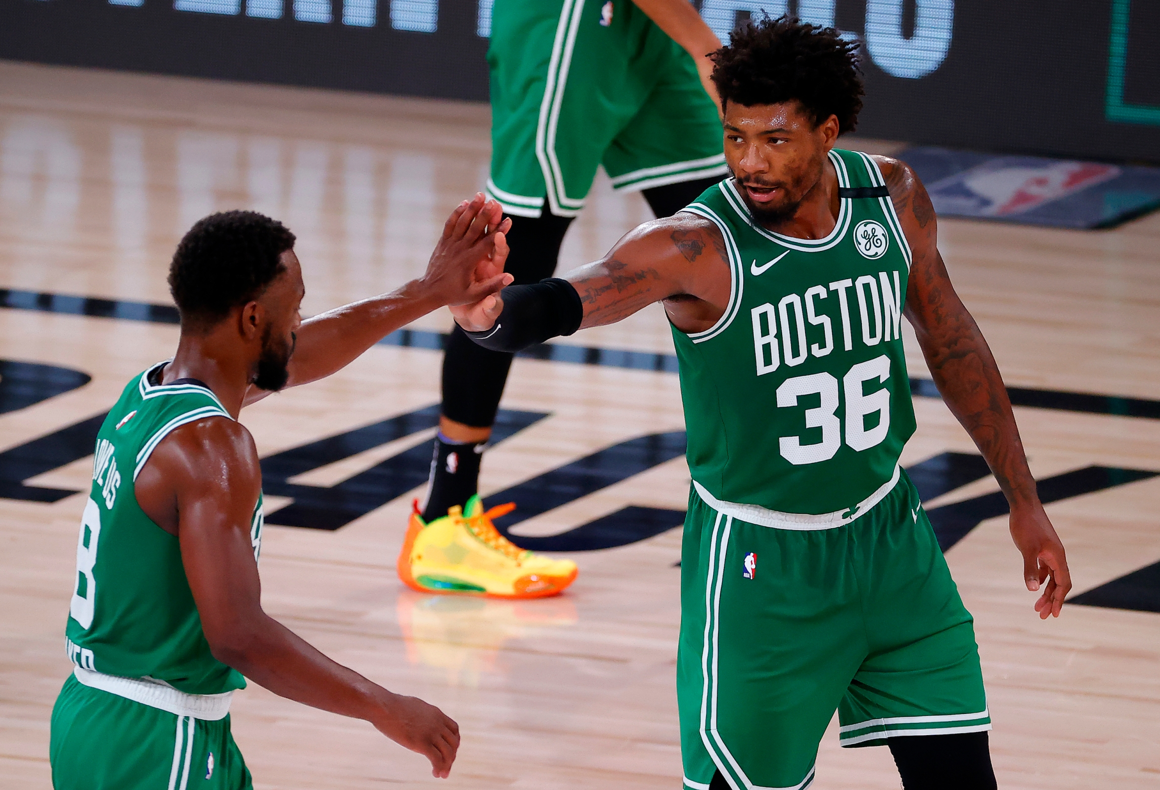 Marcus Smart and Kemba Walker of the Boston Celtics high five