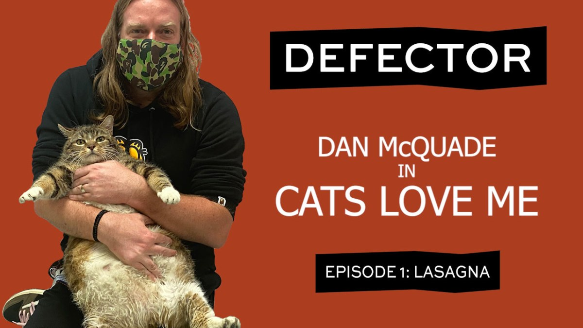 """A title card. It has a man (Dan McQuade) holding a giant fat cat. He's wearing a Garfield hoodie (the man, not the cat). The header says """"DEFECTOR: Dan McQuade in Cats Love Me. Episode 1: Lasagna."""""""