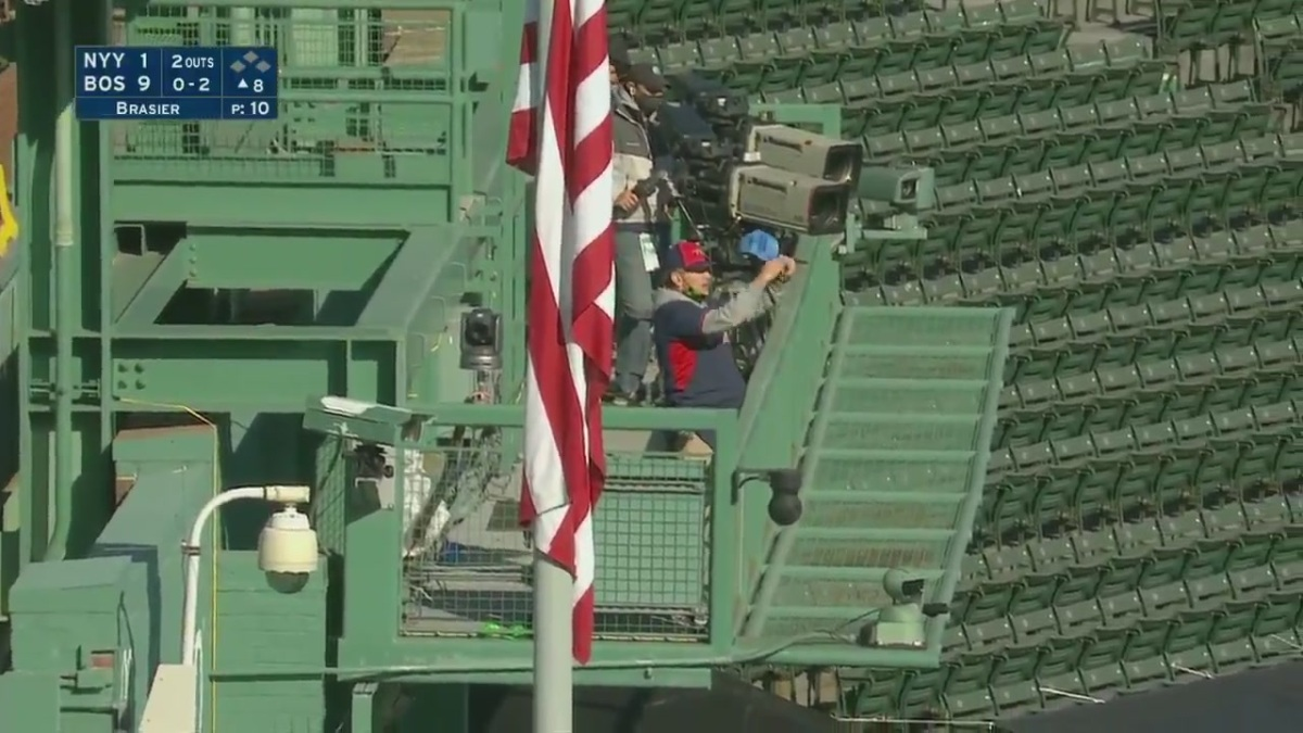 A fan stands in the stands and disrupts the game at Fenway Park