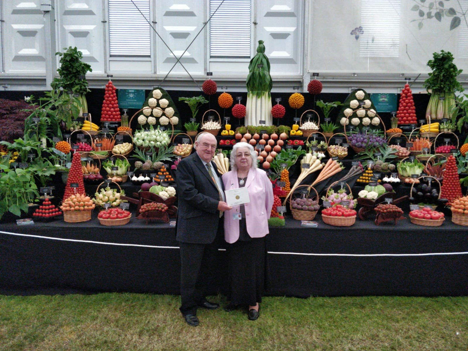 Medwyn and Gwenda Williams pose in front of their award-winning display at the 2019 Chelsea Flower Show