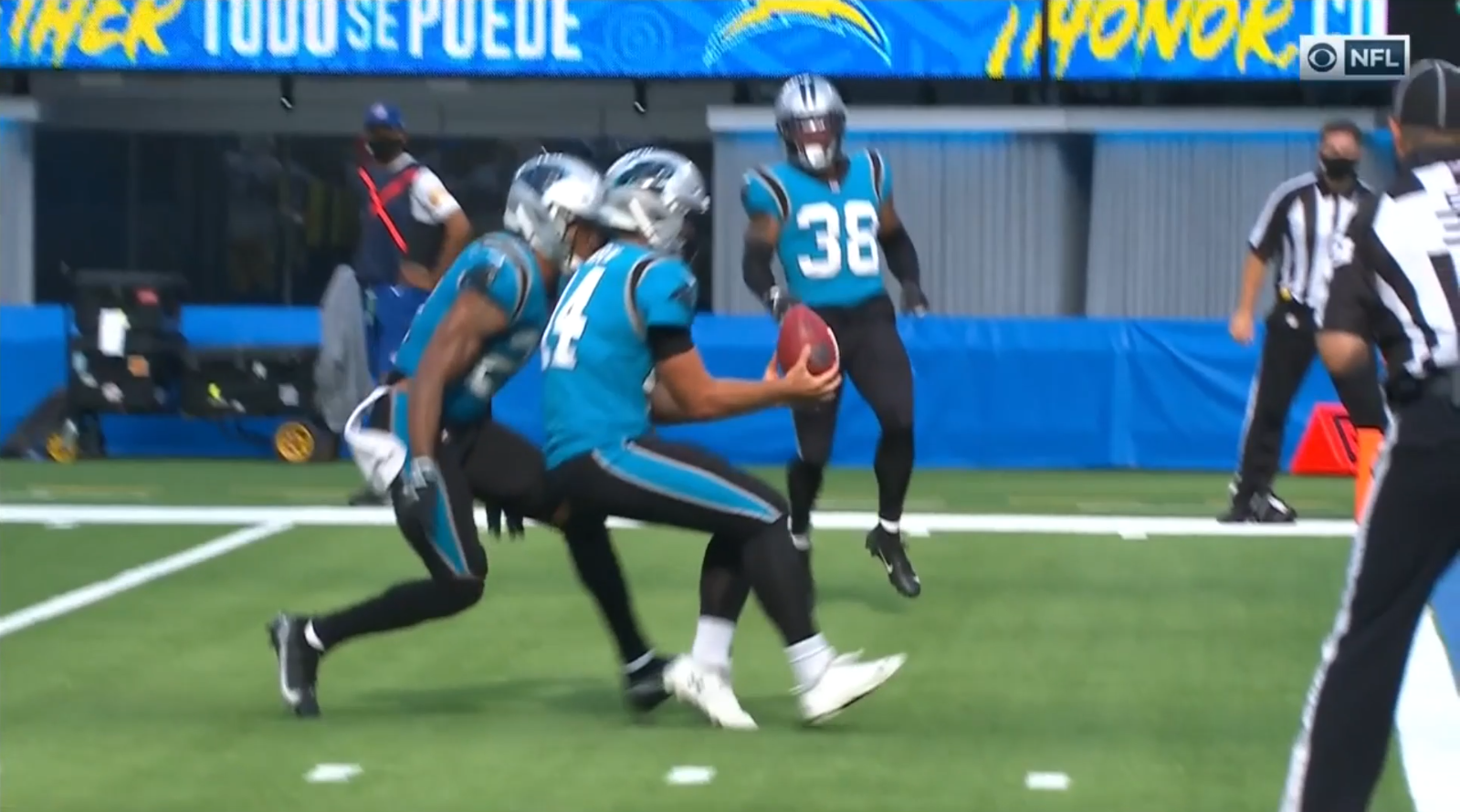 J. J. Jansen downs a punt for the Carolina Panthers near the end zone