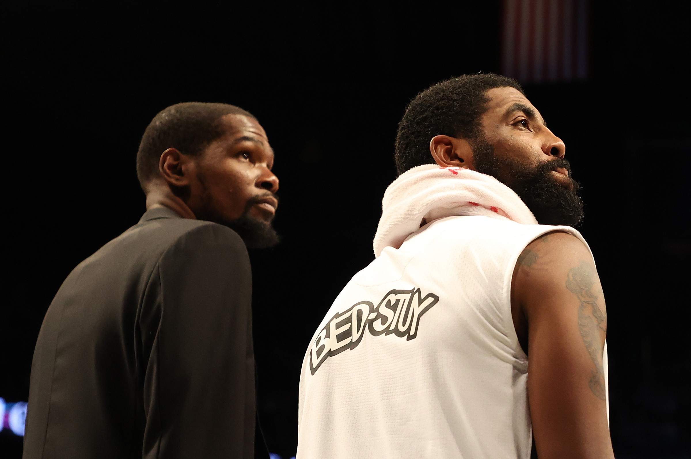 Kevin Durant and Kyrie Irving look in the same direction.