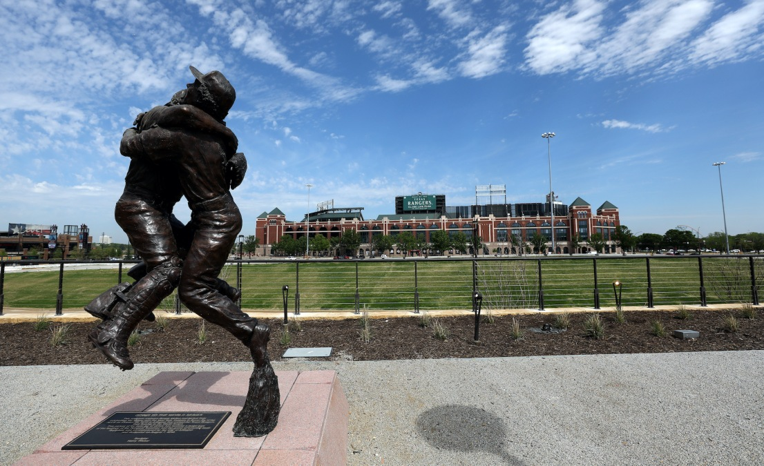 """ARLINGTON, TEXAS - MARCH 26: The """"Going to the World Series"""" sculpture by Harry Weber is seen in front of Globe Life Park, the prior home of the Texas Rangers on March 26, 2020 in Arlington, Texas. The Rangers had to delay their March 31, 2020 debut opening of Globe Life Field after Major League Baseball postponed the start of its season due to the COVID-19 outbreak. (Photo by Ronald Martinez/Getty Images)"""