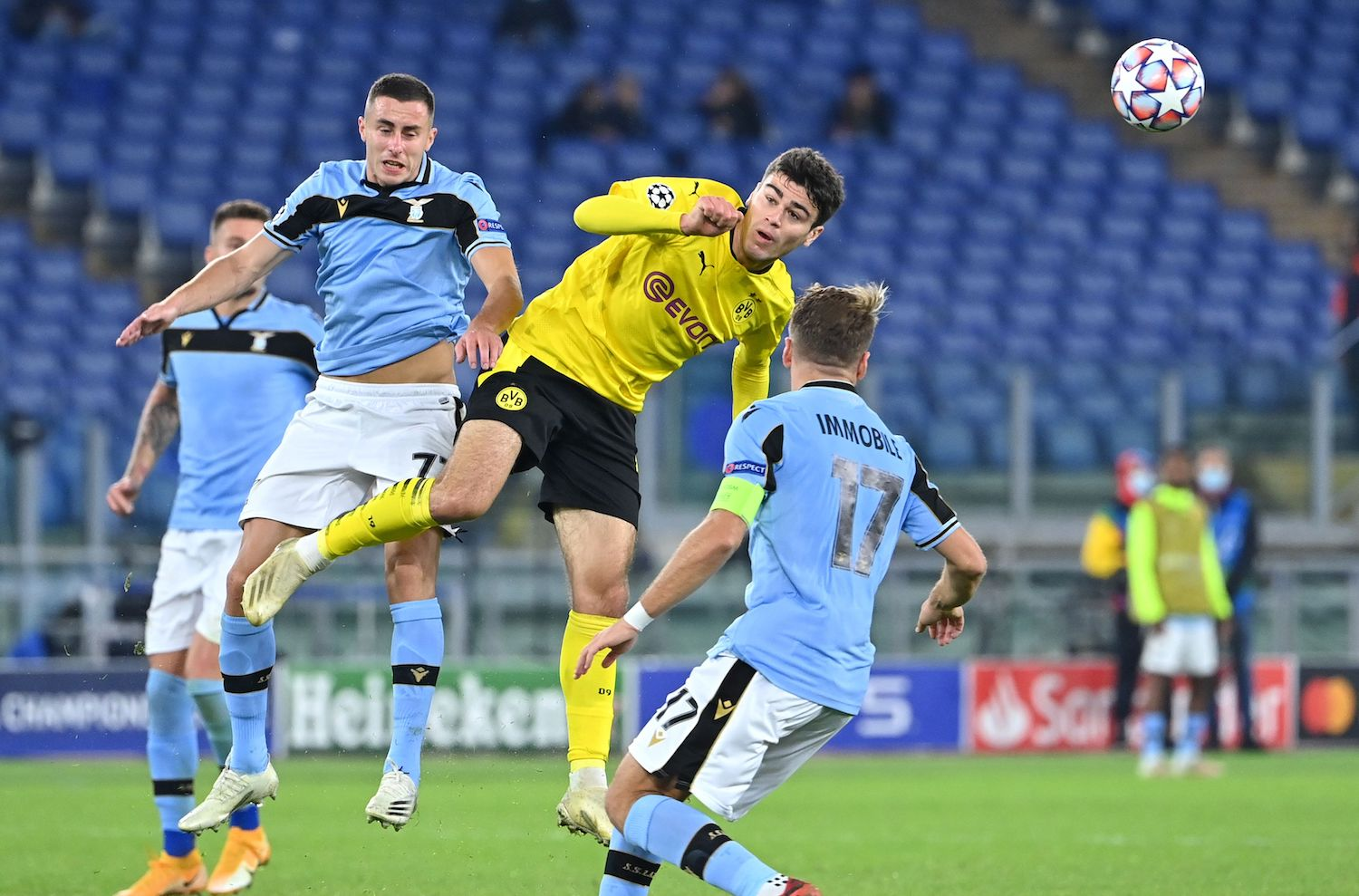 Borussia Dortmund's American forward Giovanni Reyna (C) is challenged by Lazio's Montenegrin midfielder Adam Marusic during the UEFA Champions League first round first leg, group F, football match between Lazio and Borussia Dortmund, at the Olympic stadium in Rome, on October 20, 2020. (Photo by Alberto PIZZOLI / AFP) (Photo by ALBERTO PIZZOLI/AFP via Getty Images)