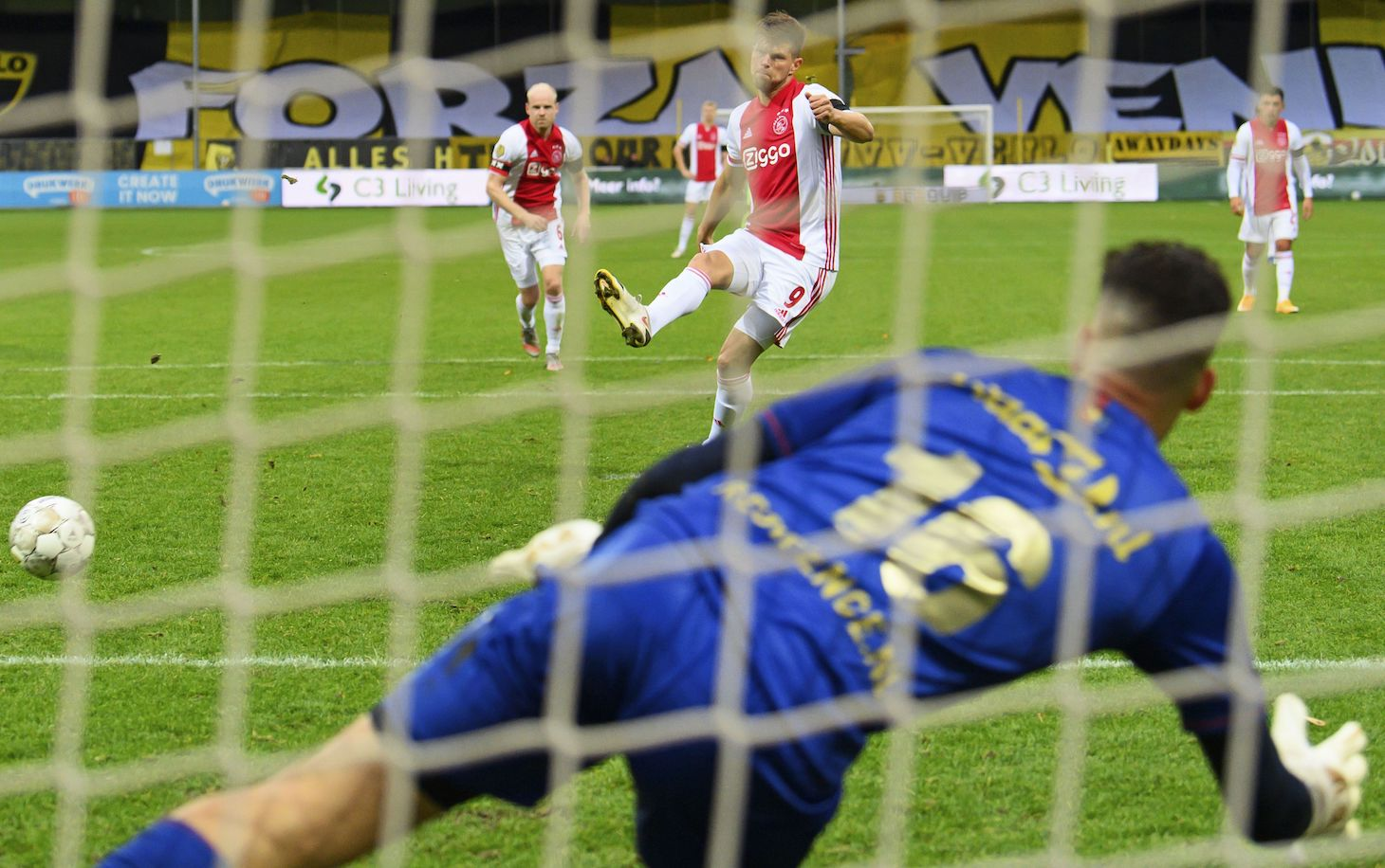 Ajax' Dutch forward Klaas Jan Huntelaar (C) scores the 0-10 goal during the Dutch Eredivisie football match between VVV Venlo and Ajax Amsterdam at De Koel stadium in Venlo, south-eastern Netherlands, on October 24, 2020. - Ajax won 13-0 against VVV Venlo, the biggest victory in the history of the Dutch championship.
