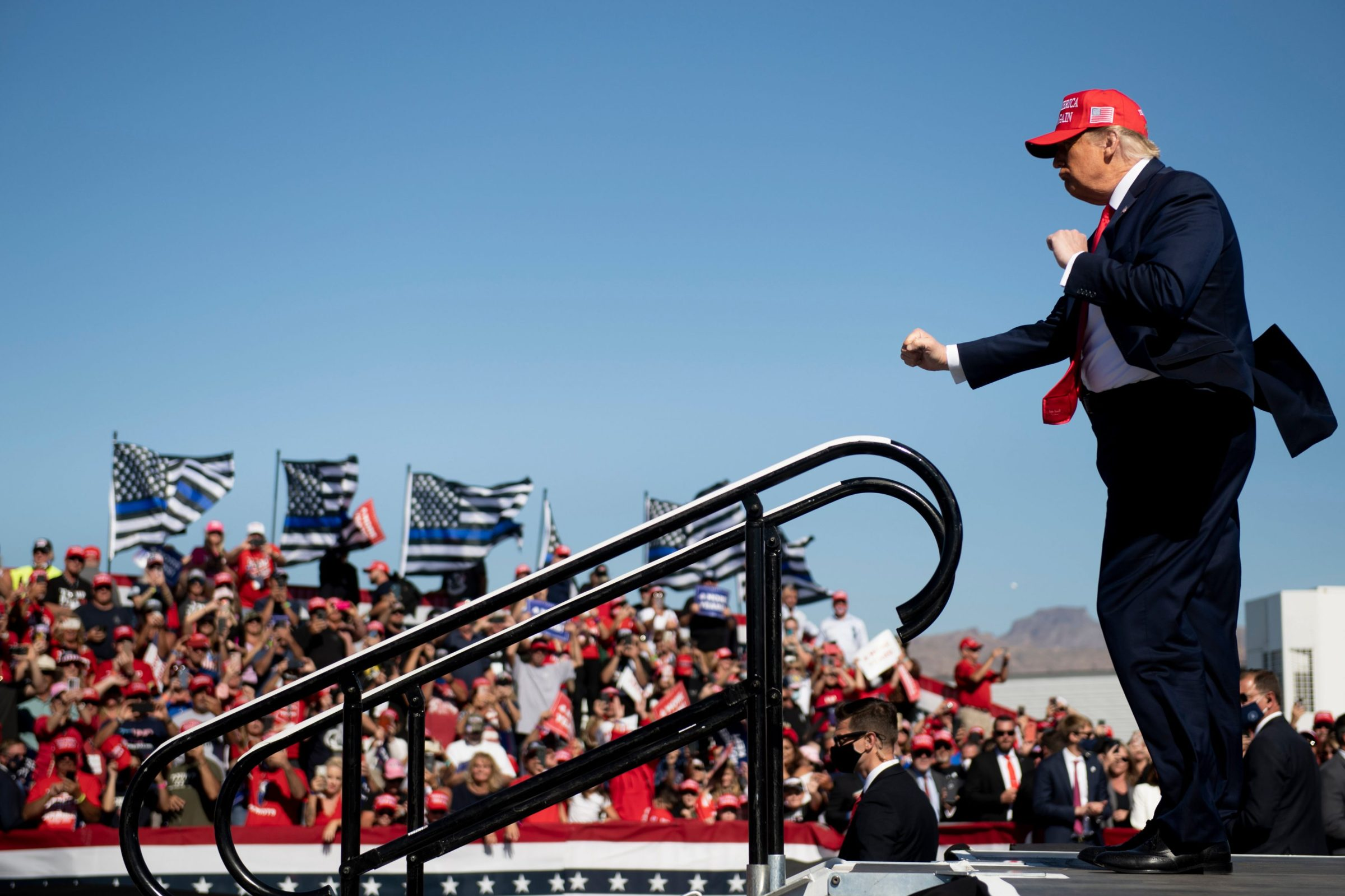 US President Donald Trump dances as he leaves after speaking during a Make America Great Again rally